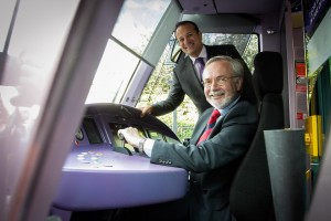 All systems go: EIB President Werner Hoyer takes the controls of a Luas tram with Minister Varadkar.