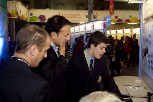 Minister for Transport, Tourism and Sport Leo Varadkar TD with Peter Evans, BT Ireland and Dylan Murray from Castleknock College and his project 'How Parabolic reflectors can increase/limit a wireless network'