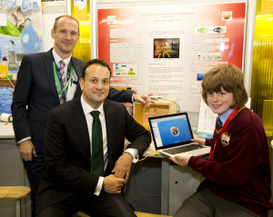 Minister for Social Protection Leo Varadkar TD and Peter Evans, BT with Stephen Cushen , student at St. Declan's College Dublin and his project 'Li-Pi'.